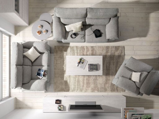 Distribuir un piso pequeño. Sofá y butacas de la colección Theo de Kibuc.